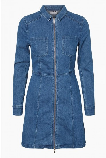 7d08385fe0 This long sleeve denim dress is a must-have. Featuring a mid wash denim
