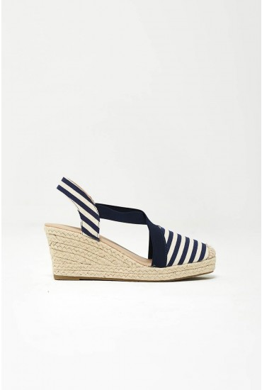 9046fa23e025 Step up your summer shoe game with these espadrille wedges. Featuring a  woven sole in a classic navy and white striped design