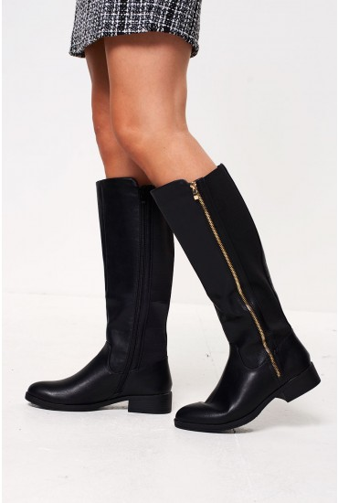 089936708c1e Complete your look with these faux leather flat knee boots. Features flat  sole and contrast elastic paneling