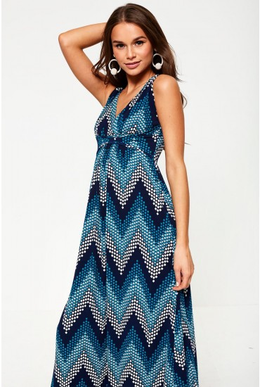20c49dc295d Get your holiday wardrobe ready with this printed maxi dress in teal.  Featuring a sleeveless design