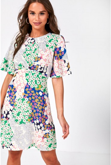 97ba7b17b9ef This floaty all over floral print mini dress is a true showstopper.  Featuring a classic round neck, elegant angel sleeves and nipping in  slightly at the ...