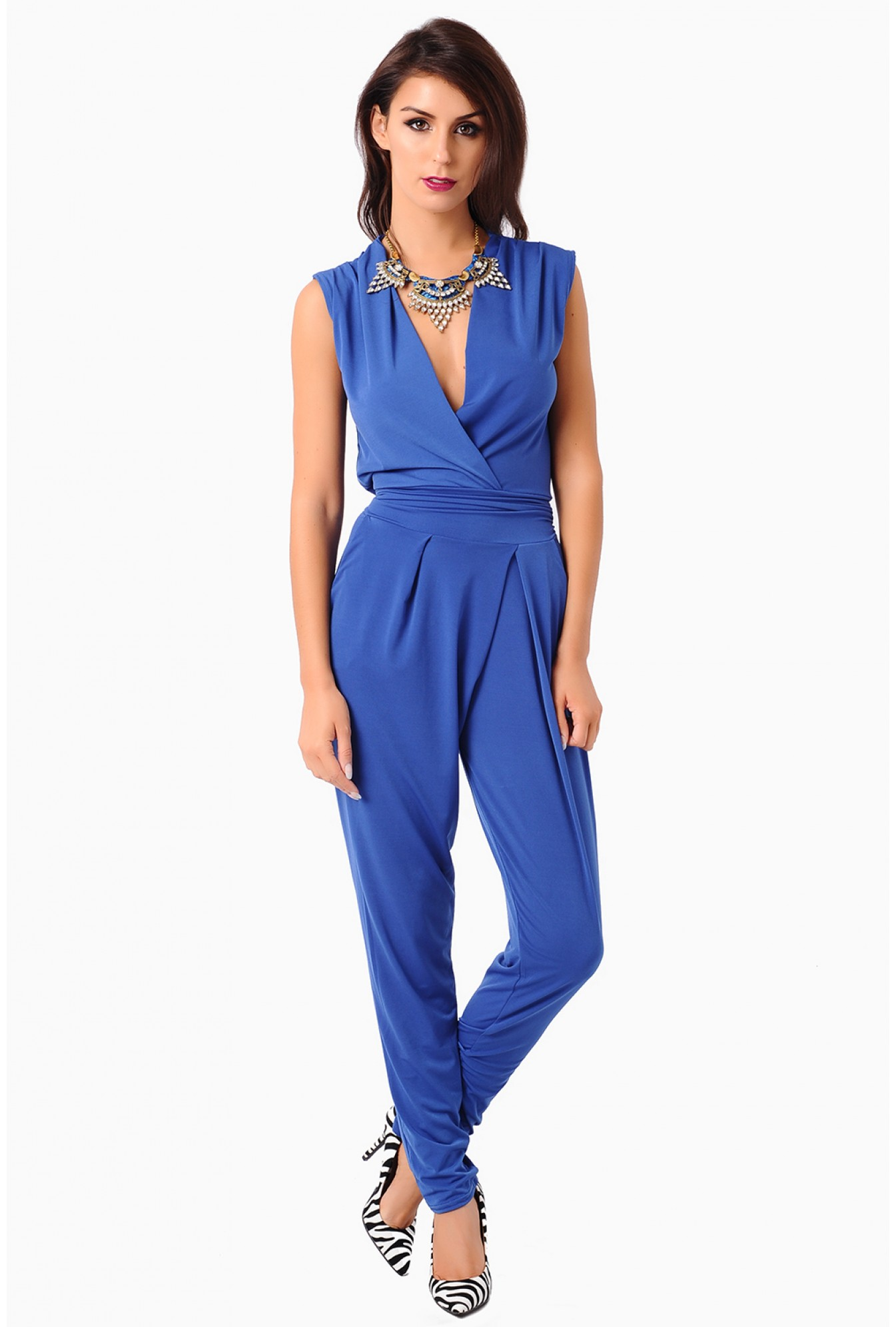 8a482986c75 More Views. Hayley Deep V Jumpsuit in Blue. John Zack