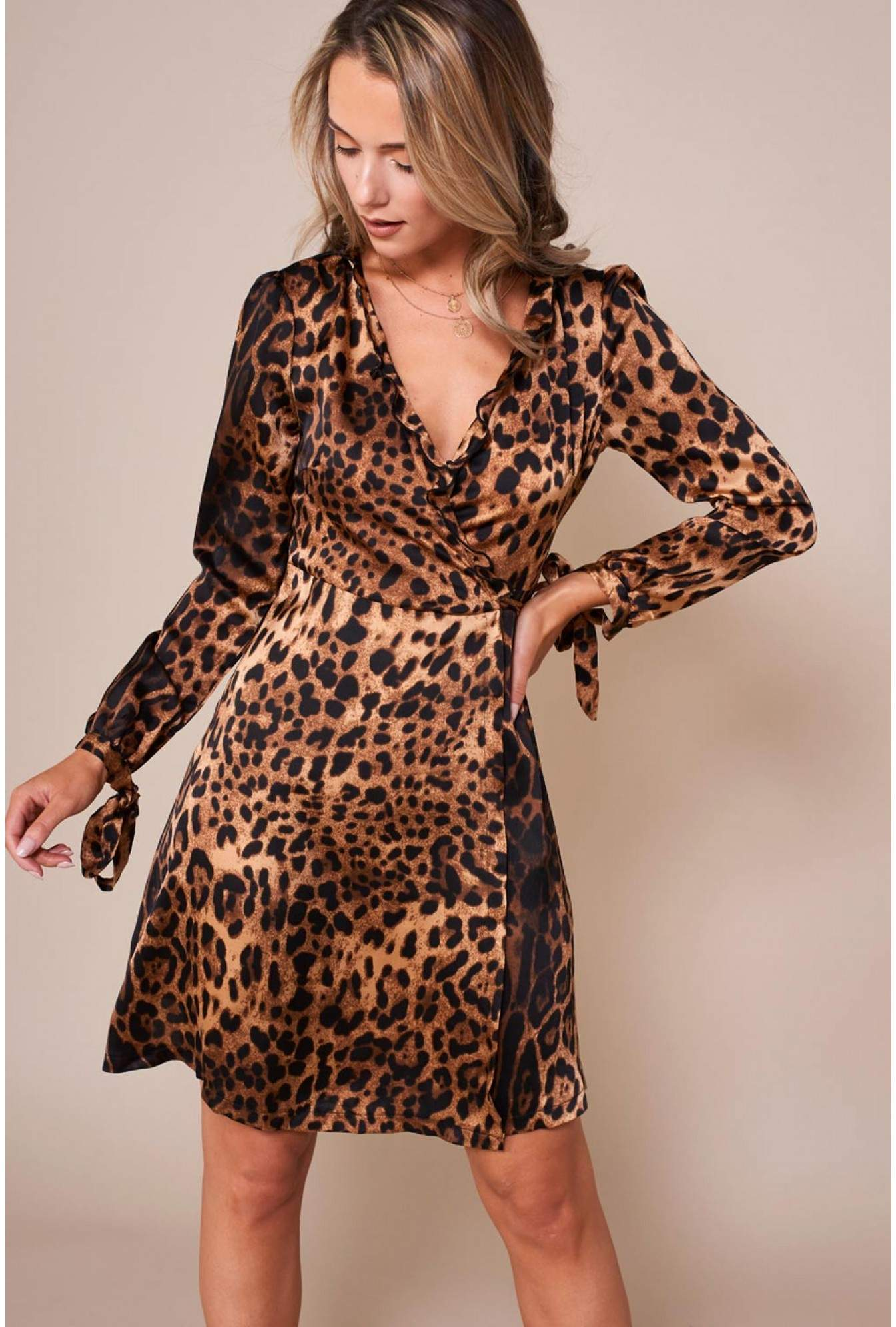 95fe04c2b8 More Views. Lil leopard Print Wrap Dress