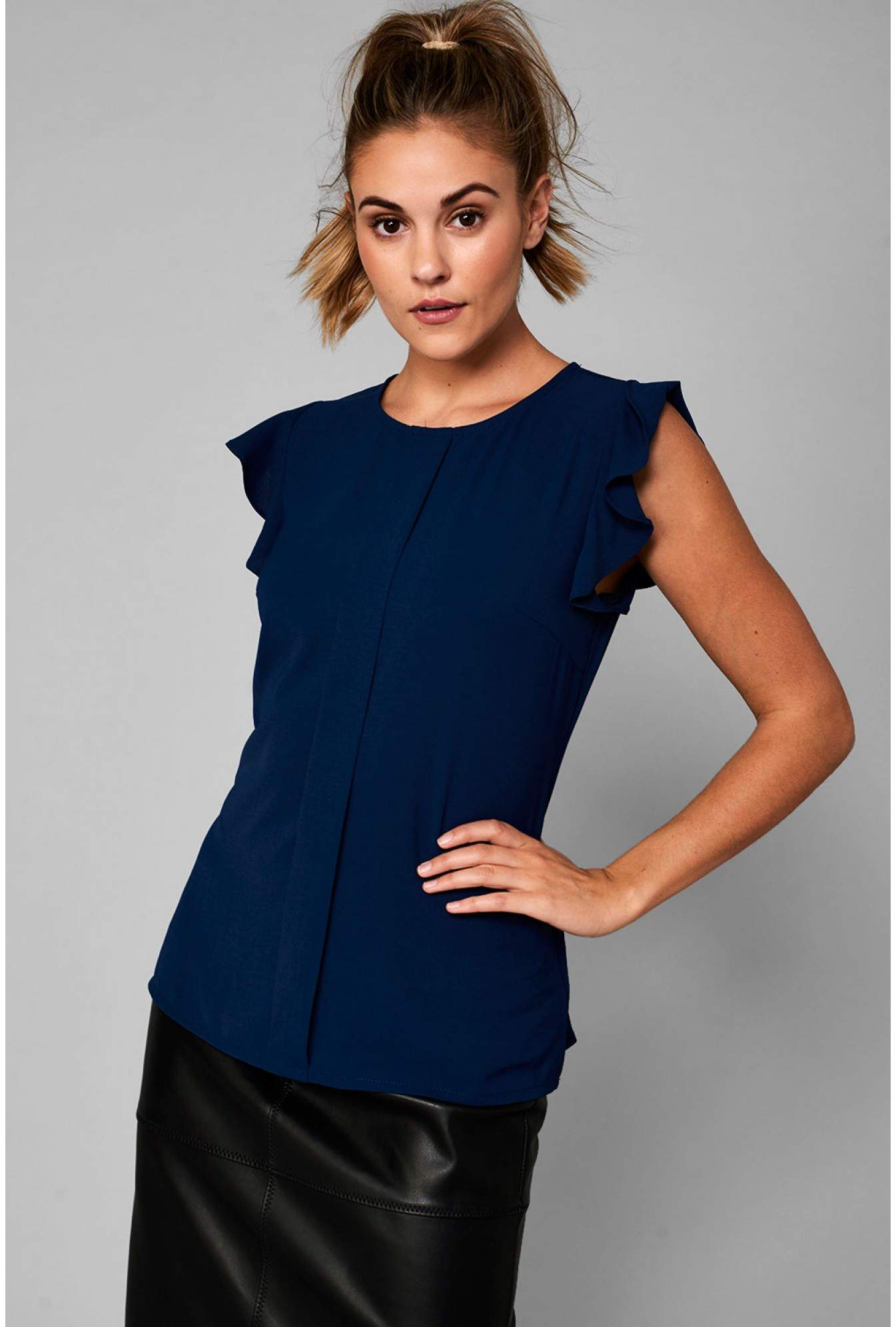 fe8214223851d0 More Views. Monja Frill Cap Sleeve Top in Navy. Marc Angelo