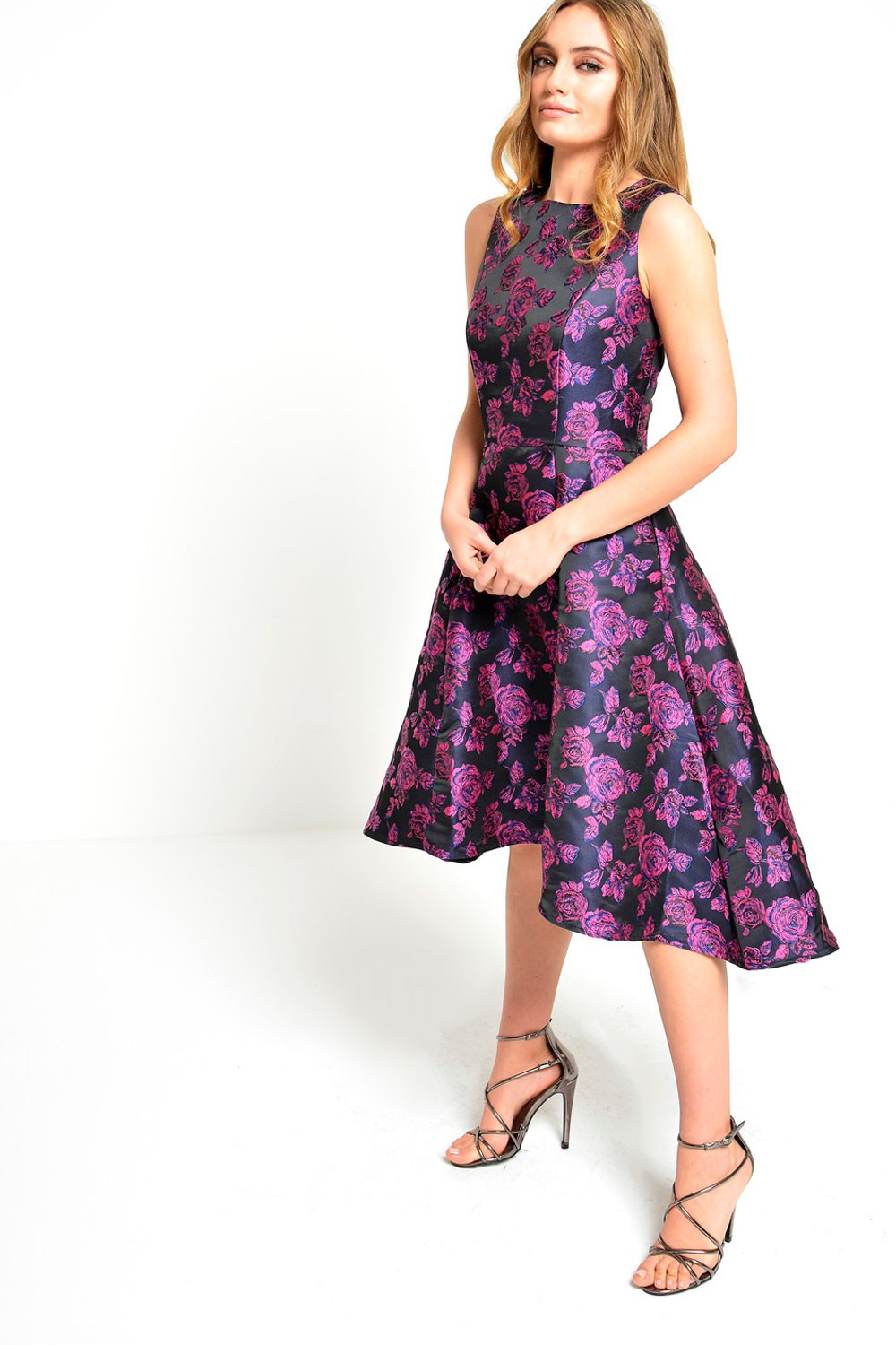 This lustrous brocade dress is full of eye-catching details like a deep V-neck, a layered peplum, and flounced three-quarter sleeves. By Terani Couture Polyester Back zipper; fully lined Dry clean.