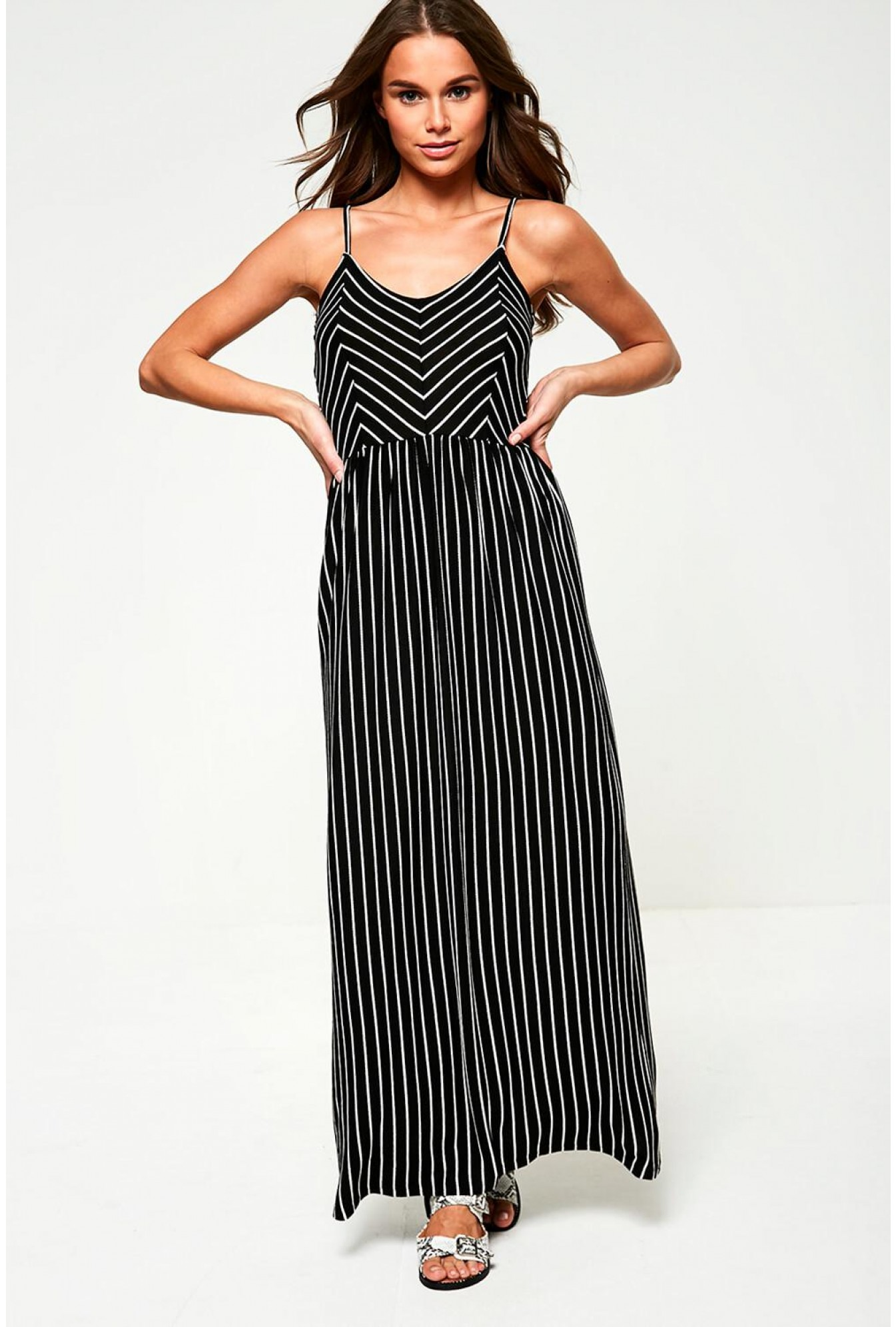 44acb0cab82 More Views. Striped Jersey Maxi Dress in Black